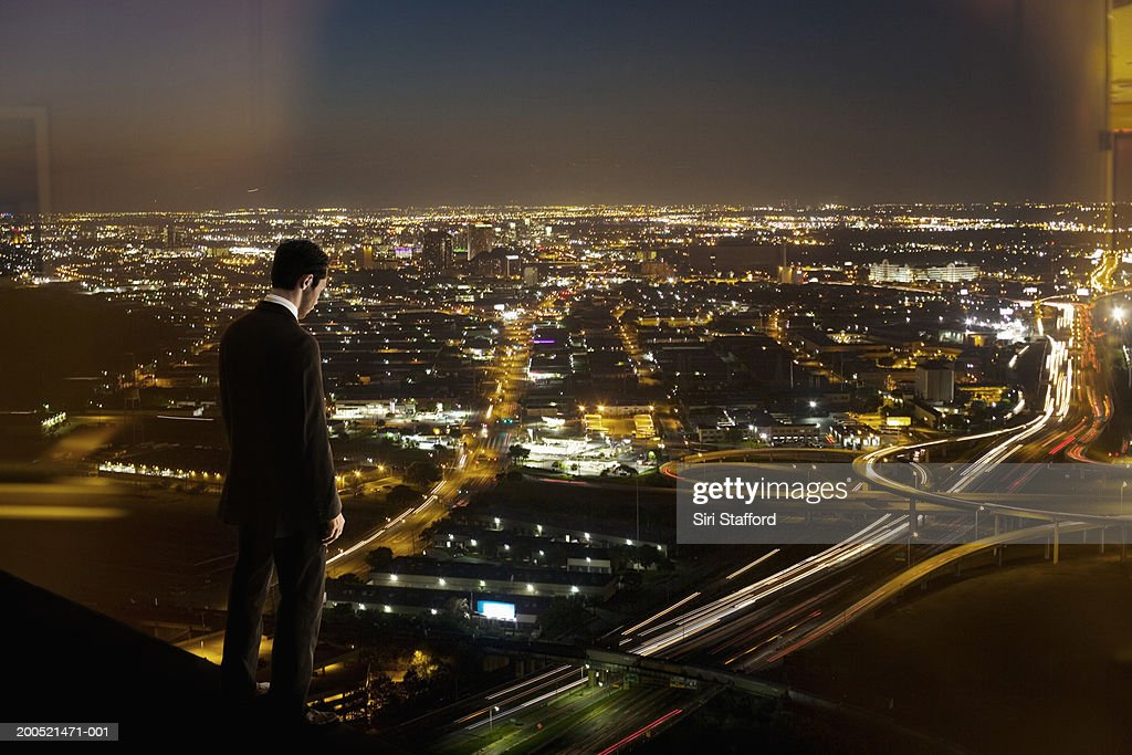 Businessman looking at cityscape (Digital Composite) : Stock Photo