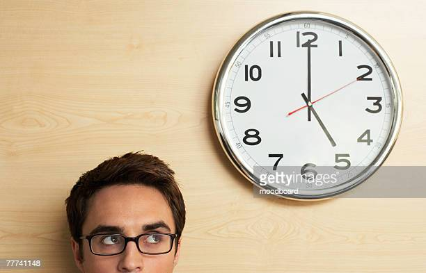 Businessman Looking at Clock