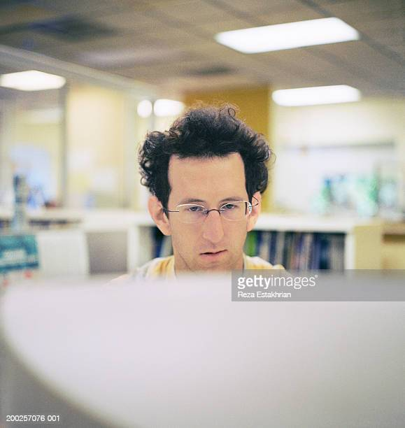 Businessman looking at computer monitor
