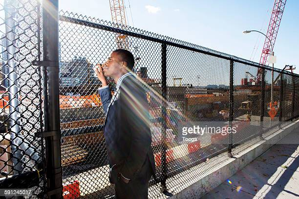 Businessman looking at construction site