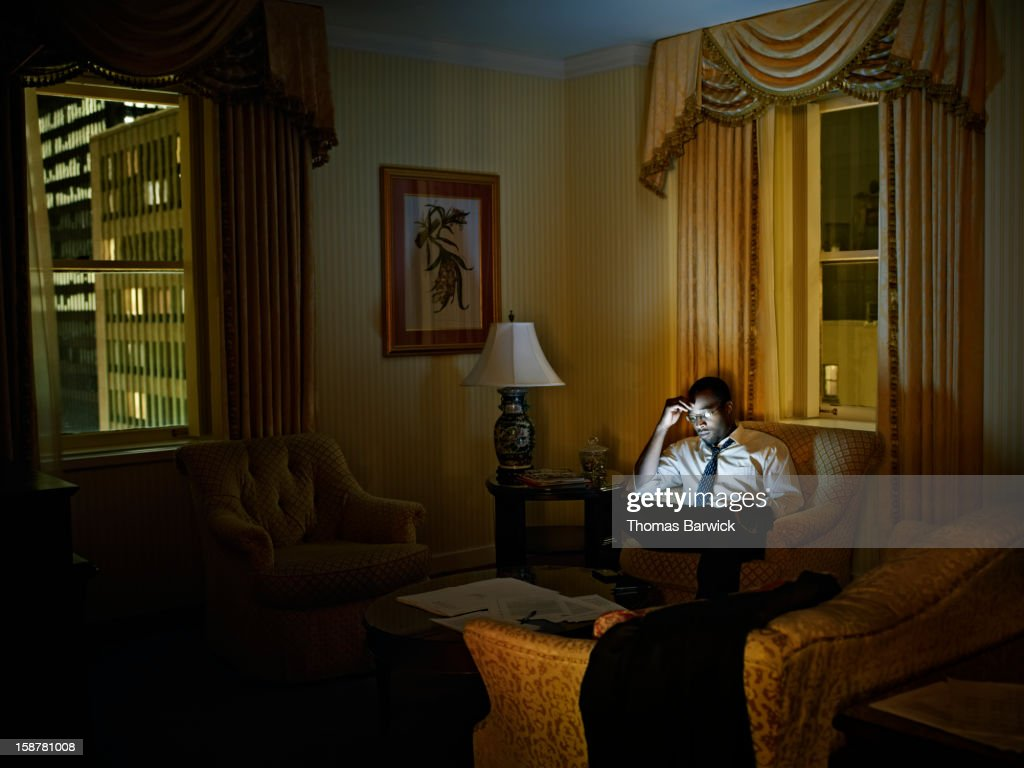 Businessman looking at digital tablet in hotel : Stock Photo