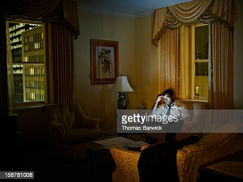 Businessman looking at digital tablet in hotel : ストックフォト
