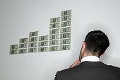 Businessman Looking at Hundred Dollar Bills