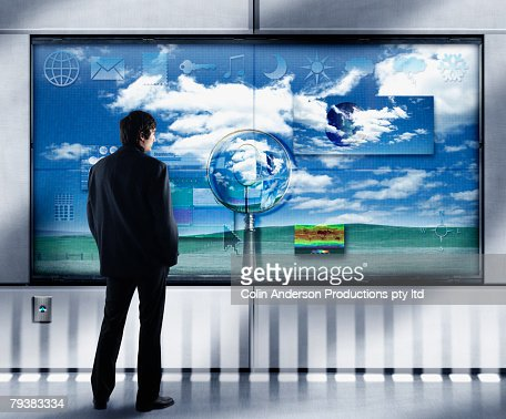 Businessman looking at interactive video display
