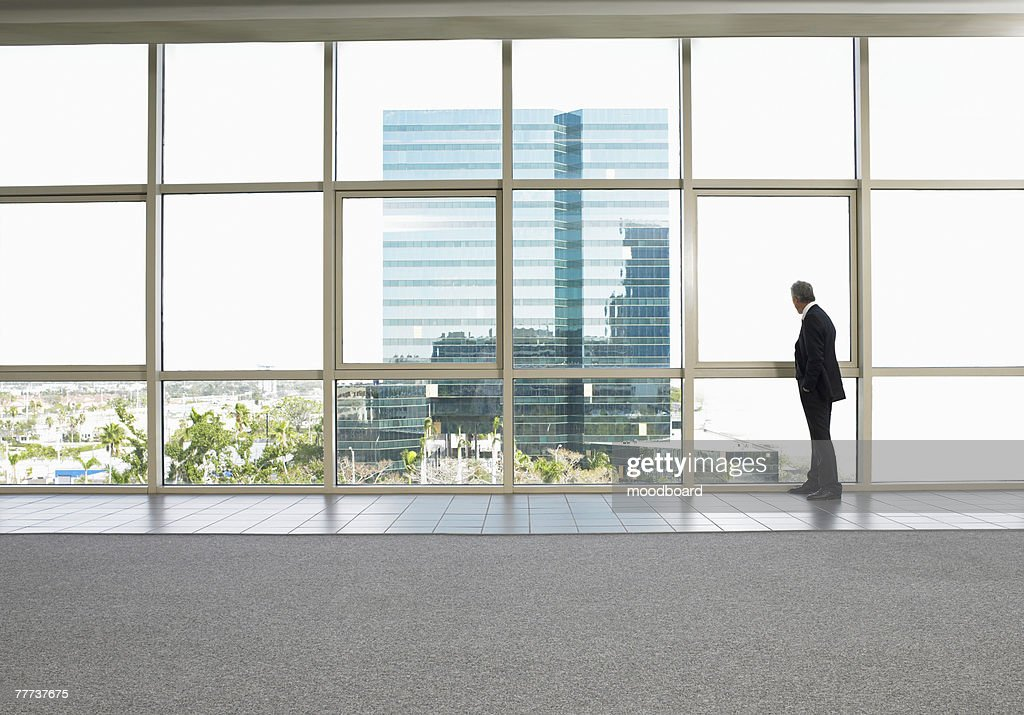 Businessman Looking at Office Building Next Door : Stock Photo