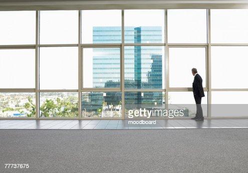 Businessman Looking at Office Building Next Door : Stock-Foto