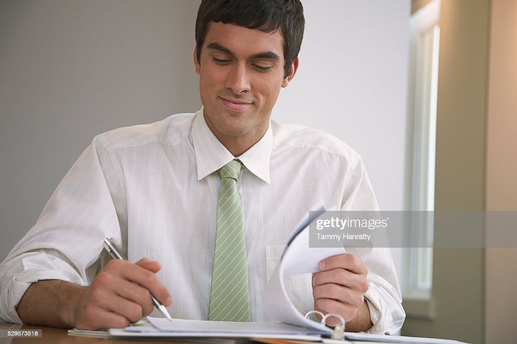 Businessman looking at paperwork : Stock Photo
