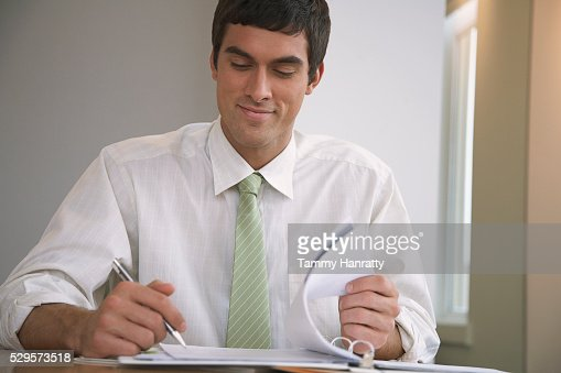 Businessman looking at paperwork : ストックフォト