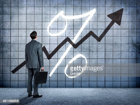 Businessman Looking At Prospect Of Higher Interest Rates