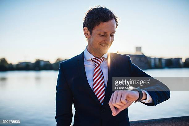 Businessman looking at smartwatch.