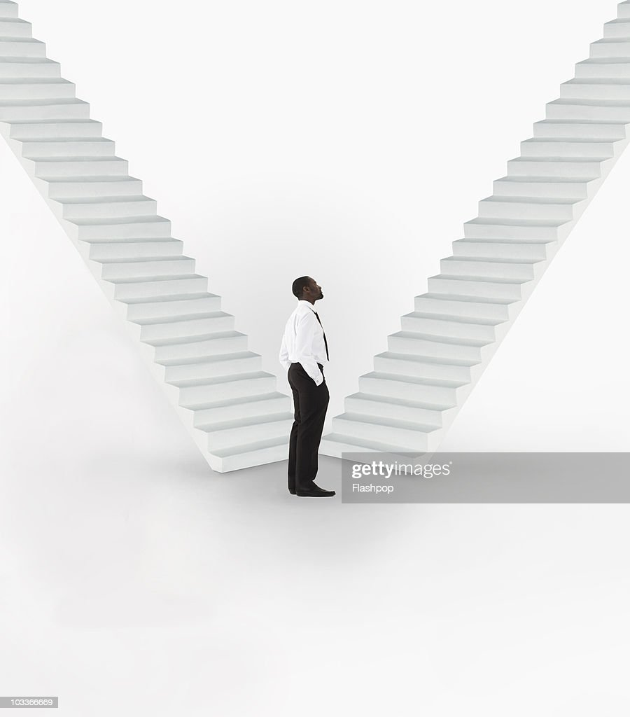 Businessman looking at stairway : Stock Photo