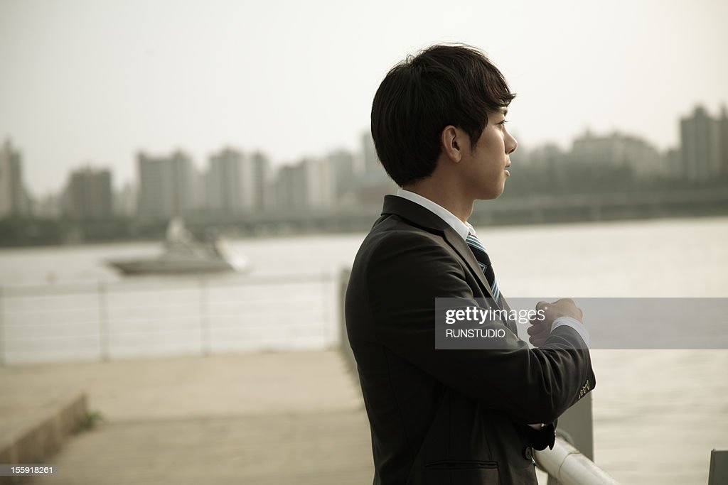businessman looking at the river : Stock Photo