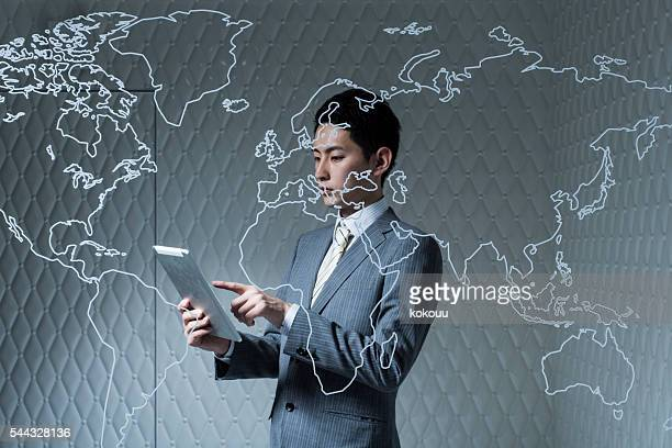 Businessman looking at the tablet in the company