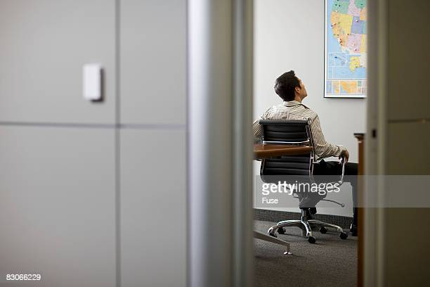 Businessman Looking at United States Map