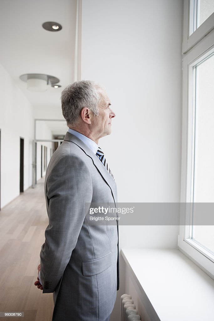 Businessman looking at window : Stock Photo