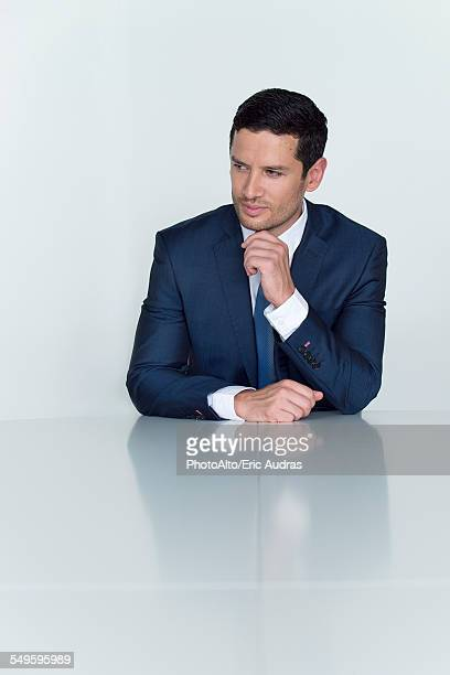 Businessman looking away in thought, portrait