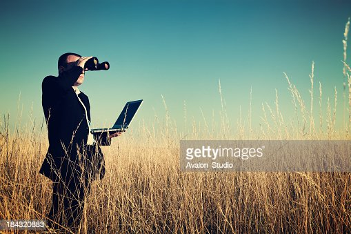 Businessman looking field for investment.