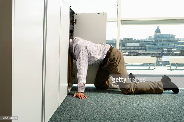 Businessman Looking in Cabinet