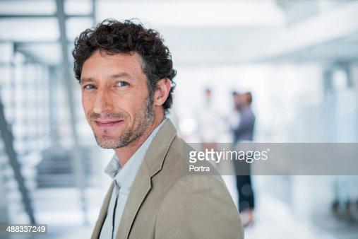 Businessman looking into camera