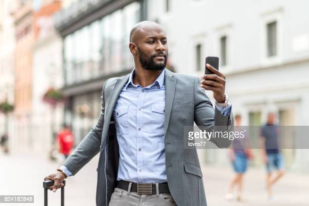 Businessman looking navigation on smart phone