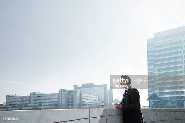 Businessman looking out across the city.