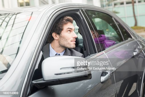 businessman looking out car window stock photo getty images