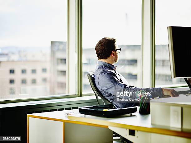 Businessman looking out of office windows