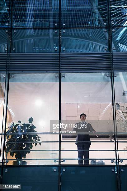 Businessman looking out of the office window