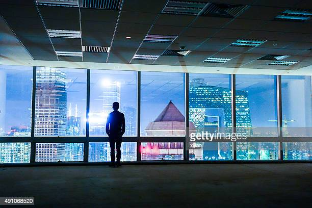 Businessman looking out of window