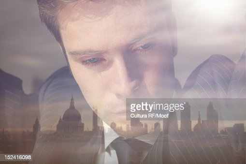 Businessman looking out office window : Photo