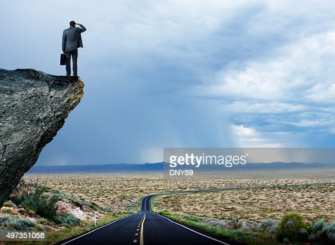 Businessman Looking Out Towards Long Lonely Desrt Highway