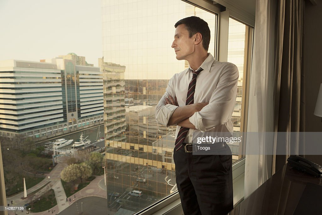 Businessman looking out windown : Stock Photo