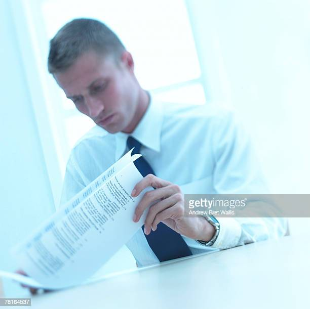 Businessman looking over documents