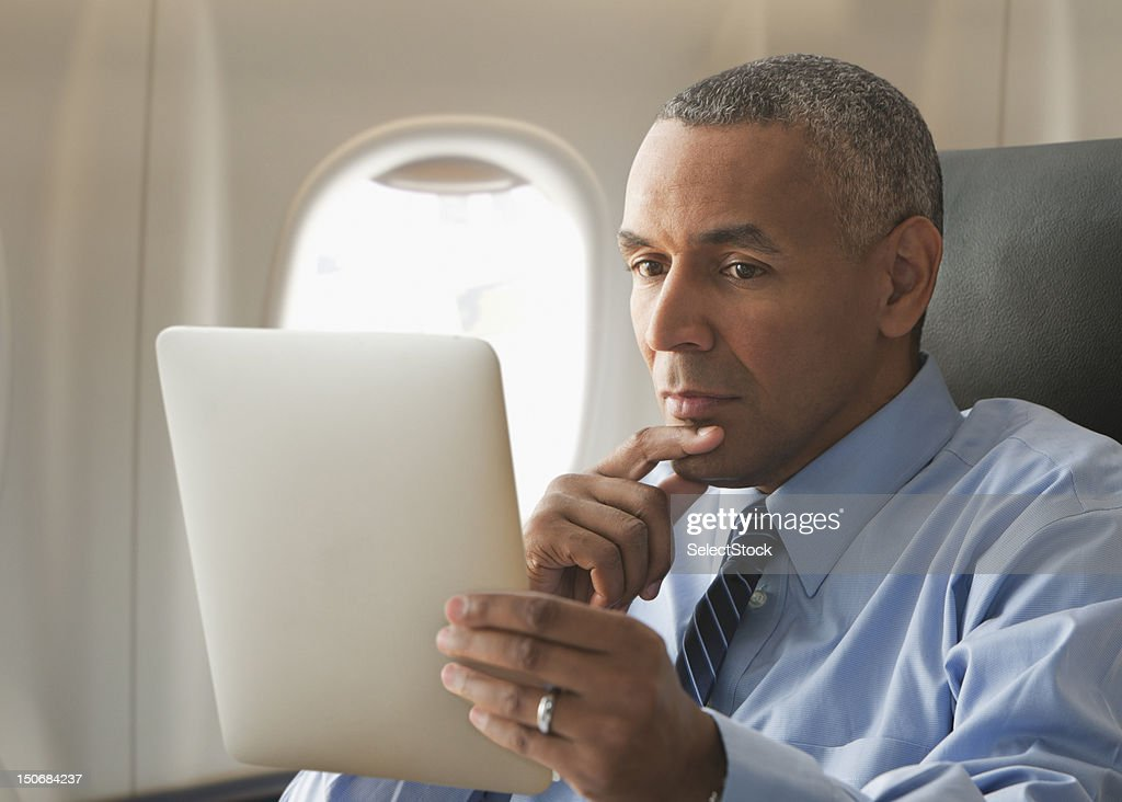 Businessman looking over electronic tablet : Stock Photo