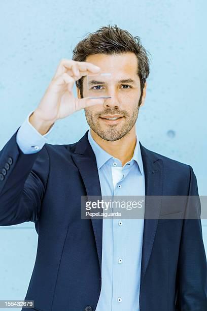 Businessman looking through a lens