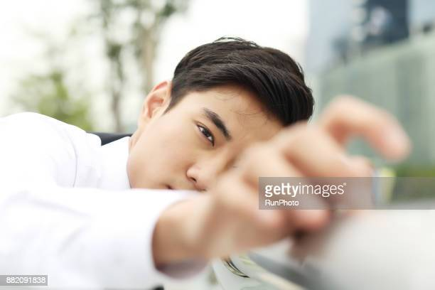Businessman looking through finger