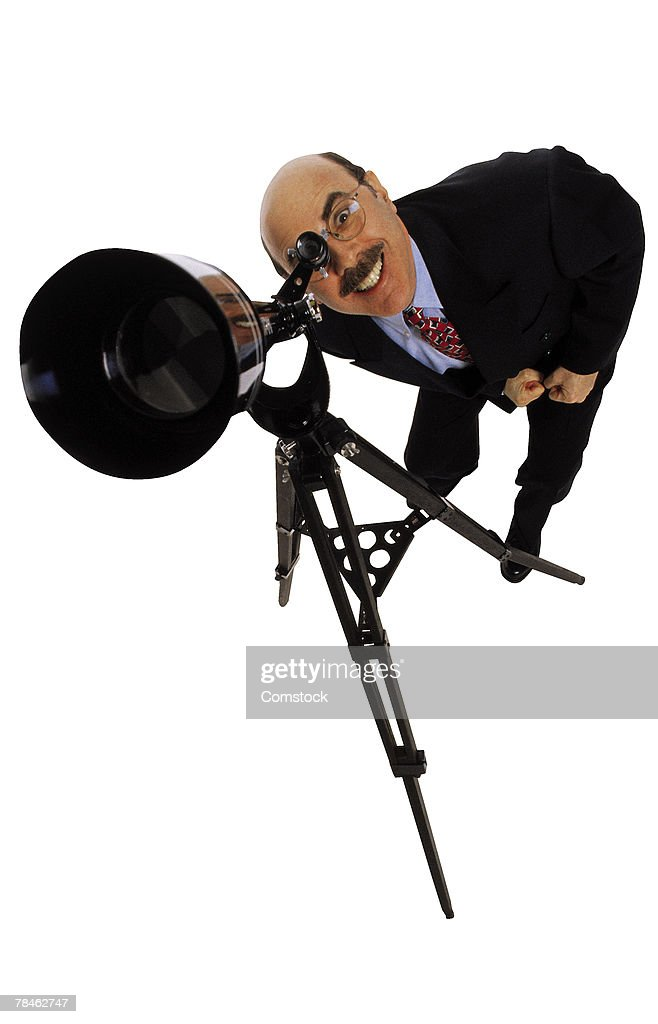 Businessman Looking Through Telescope Stock Photo | Getty ...