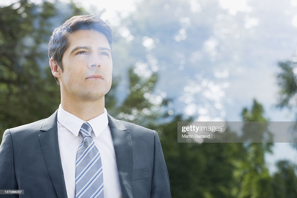 Businessman looking through window : Stock Photo