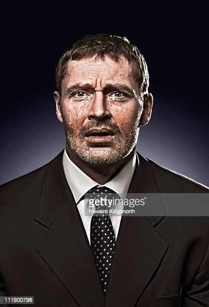 businessman looking to camera, crying