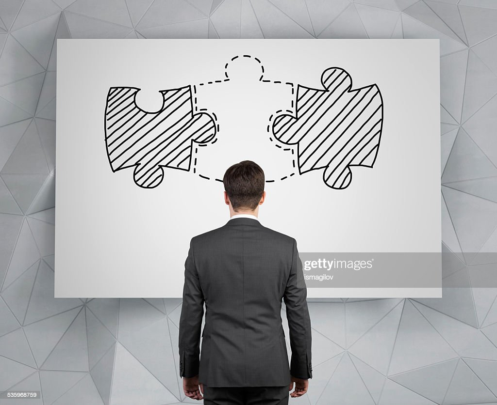 businessman looking to puzzle : Stock Photo