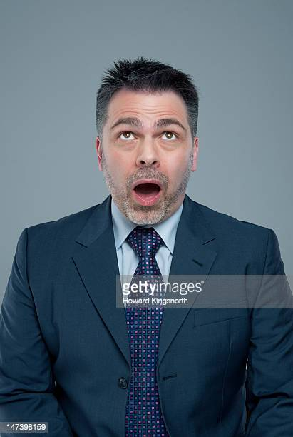 businessman looking up in amazement