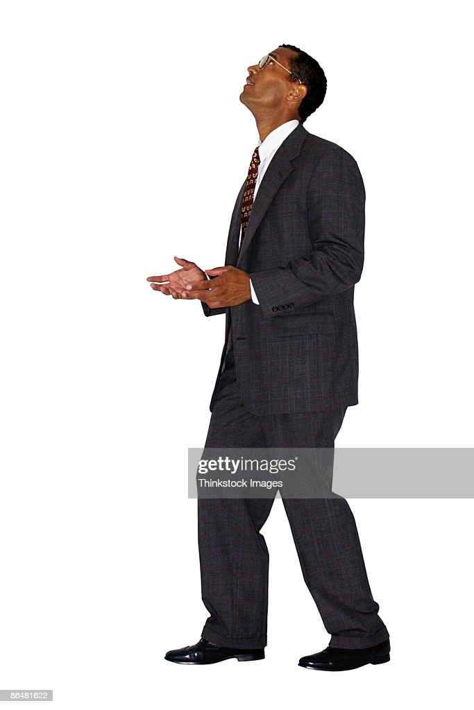 Businessman looking up : Stock Photo