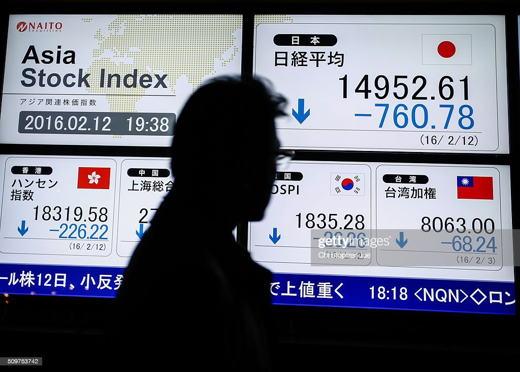 A businessman looks at a stock market indicator board on February 12, 2016 in Tokyo, Japan. The Nikkei Stock Average finished 11% down for the week, its biggest weekly drop since October 2008, and the index for the day ended 4.8% down, the lowest since October 2014.