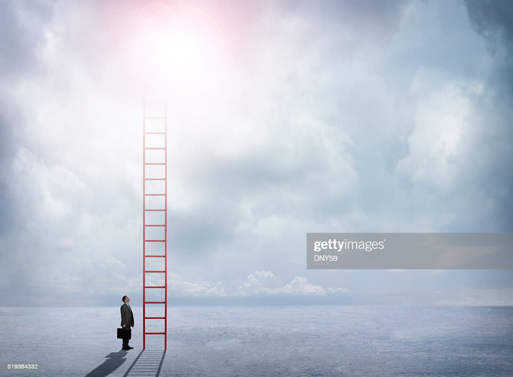 Businessman Looks Up At Red Ladder Extending Into The Clouds : Stock Photo