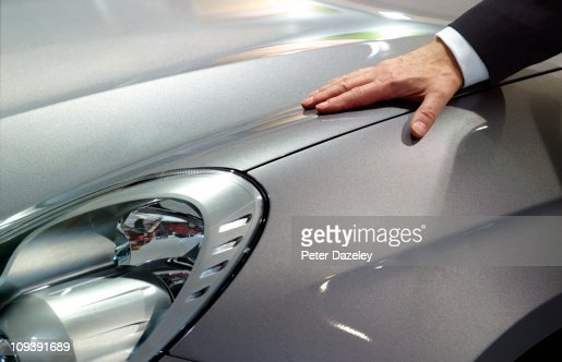 Businessman loves his car : Stock-Foto
