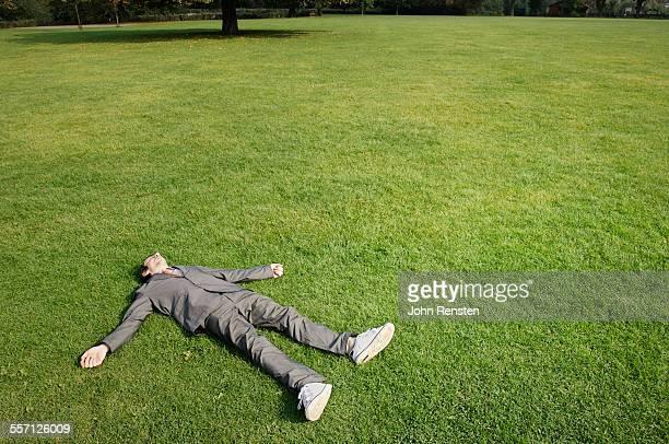 Businessman Lying Down in Park