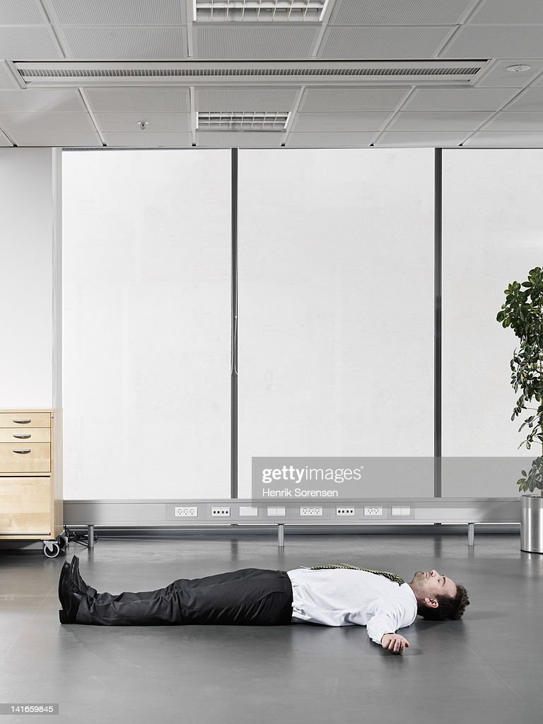 businessman lying on the floor : Stock Photo