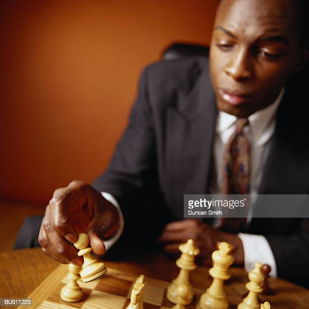Businessman Making a Chess Move