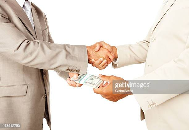 Businessman making a deal and exchanging money