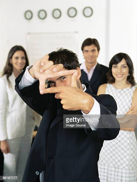 Businessman making a frame with his fingers